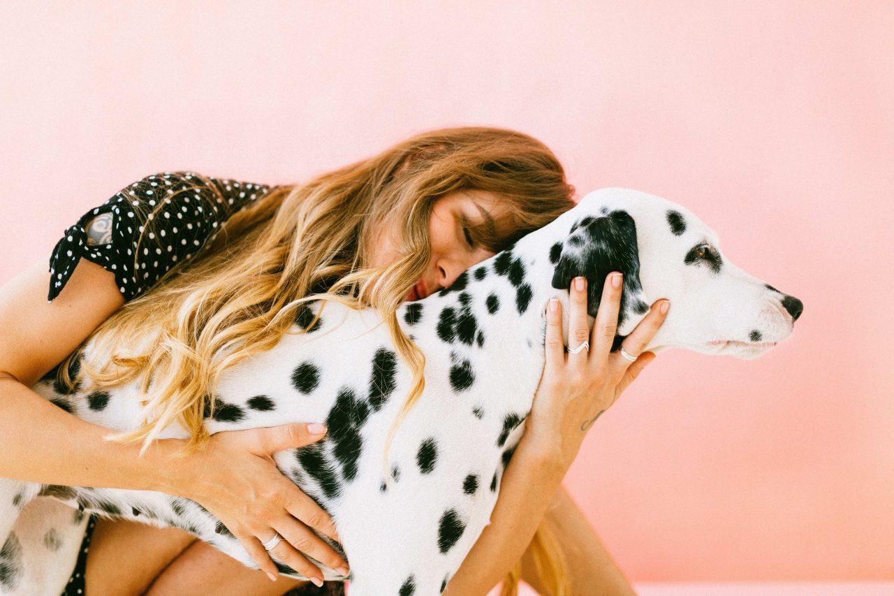 Woman hugs dog